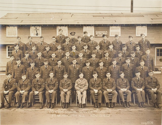 Before Restoration (notice the reddish stain on a soldier's tie (third row from top, near center).